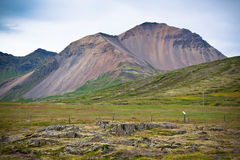 Iceland Caked Lava field and mountains landscape Stock Photography