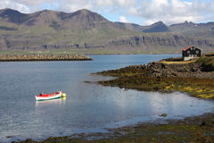 Iceland - Djupivogur. Small fishing town. Mountains and fiord Royalty Free Stock Photos