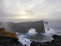 Iceland - Dyrh�laey, the arch with the whole in the sea stock photography