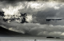Fog rolling in over the mountains, Iceland, East Coast Royalty Free Stock Photos