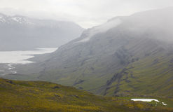 Iceland. East fiords. Berufjordur fiord with fog. Royalty Free Stock Photo