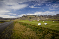 Iceland Farm Landscape. Beautiful Iceland Farm near the road with moutains behind royalty free stock photo