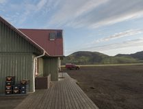 Free Iceland, Fjallabak Nature Reserve, August 1, 2019: Tourist Hut At Alftavatn Camping Site With Supplies Boxes, Red Off Stock Photo - 161016180