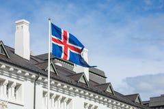 Iceland flag against summer sky. Reykjavik royalty free stock photography