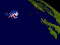 Iceland with flag on Earth Stock Photos