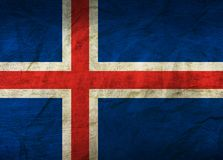 Iceland Flag on Paper. Flag on an old Paper Texture Royalty Free Stock Photo