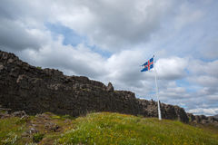 Iceland Flag at Pingvellir National Park. A photo of the where the Eurasia plate meets the North American plate with the Icelandic Flag on the Eurasia side Stock Image