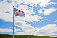 Iceland flag waves in the sky. Scandinavia Stock Images