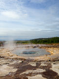 Iceland. Geology. Volcanism. Geyser in quiet state. The pool with the hot water stock images
