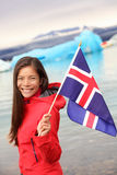 Iceland - girl holding Icelandic flag at glacier Stock Photography