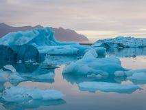 Iceland - Glacier lagoon with drifting icebergs. Beautiful glacier lagoon. Thousands of icebergs drifting lazily towards the sea, shining in many shades of blue royalty free stock photo