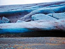 Iceland glacier. Small entrance to ice cave under blue Icelandic glacier in Iceland Stock Image