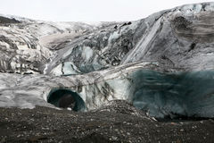 Iceland glacier with two ice arches Royalty Free Stock Images