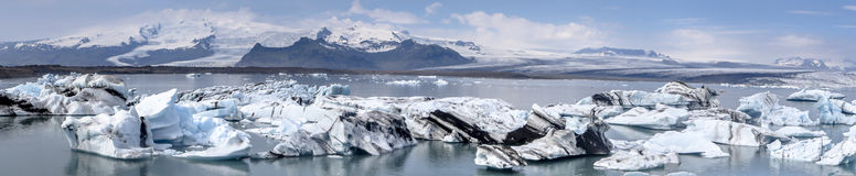 Iceland_glacierlagoon. The Iceberg Lagoon, Jokulsarlon, Iceland filled with glacial Icebergs with the Vatnajokull Glacier in the background on a sunny day Royalty Free Stock Photos