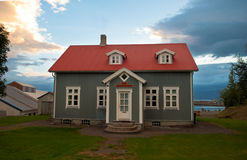 Iceland House. Wooden house in Iceland. Beautiful cloudy sky Royalty Free Stock Photography