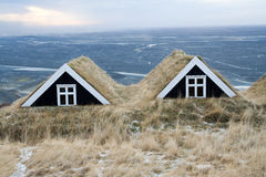 Iceland houses. Typical turf houses on a hill during winter in Iceland Royalty Free Stock Photos