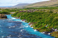 Iceland, Hraunfossar waterfalls in a beautiful summer day Royalty Free Stock Photography