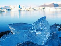 Iceland ice. Clear water turns to be ice in enormous glacier lagoon Stock Image