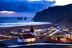 Iceland. Ic  landscape  Vik black volcanic beach and town view Royalty Free Stock Photography