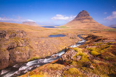 Iceland. Ic summer landscape country side panoramic view Kirkjufell mountain Stock Images