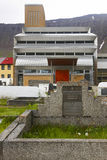 Iceland. Isafjordur modern church and cemetery. Modern church facade and cemetery at Isafjordur village in Iceland Royalty Free Stock Image