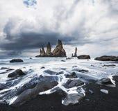Iceland, Jokulsarlon lagoon, Beautiful cold landscape picture of icelandic glacier lagoon bay, The Rock Troll Toes. Reynisdrangar cliffs. Black sand beach Royalty Free Stock Photo