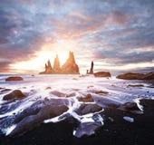 Iceland, Jokulsarlon lagoon, Beautiful cold landscape picture of icelandic glacier lagoon bay, The Rock Troll Toes. Reynisdrangar cliffs. Black sand beach Stock Photo