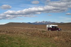 ICELAND - JULY 28. 2008: Isolated off road 4 wheel camper in waste land stock photos
