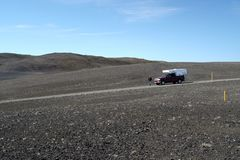 ICELAND - JULY 28. 2008: Isolated 4 wheel camper in unreal wide landscape royalty free stock photo