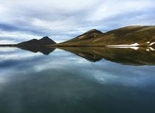 Iceland lake in summer. Beautiful water surrounded by mountains in Iceland stock image