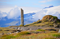 Iceland landscape. Icelandic landscape with a stone column and a glacier in the background Stock Photography