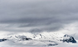 Iceland Landscape with Clouds Above the Mountain Royalty Free Stock Photography