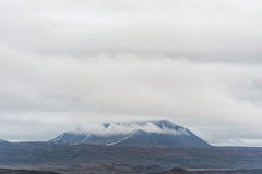 Iceland Landscape with Clouds Above the Snowy Mountain Royalty Free Stock Photo