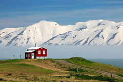 Iceland landscape. Fjord Eyjafjordur, house, mountains royalty free stock photo