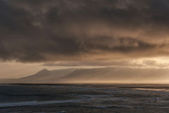 Iceland Landscape with Ocean Water and Clouds in Background Royalty Free Stock Image