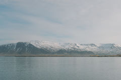 Iceland landscape photography.Snowy mountains in the background. Picture shot close to Reykjavik. Stock Photos