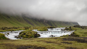 Iceland landscape. A river along a mountain with fog in Iceland stock photos