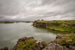 Iceland landscape. Landscape showing a lake and lava formations royalty free stock photos