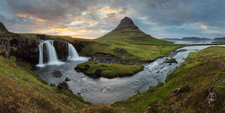 Iceland landscape with volcano and waterfall Stock Photos