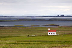 Iceland: Lonely church in tundra. Small chuch in a solitude somewhere in vast tundra by the coast in Snaefellsnes peninsula Stock Images