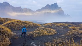 Iceland - Man and tall mountains stock photo