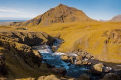 Iceland, mountain river, rock in the background. Iceland, mountain river with strong flow, beautiful landscape Royalty Free Stock Photos