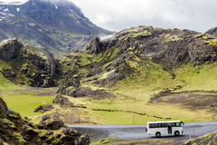 Iceland mountain view with bus. Waiting for tourists Stock Photo