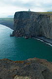 Iceland, Northern Europe, Dyrholaey, lighthouse, Vik, nature, landscape, climate change, black, beach. Panoramic view of the cliffs with the Dyrholaey lighthouse stock photography