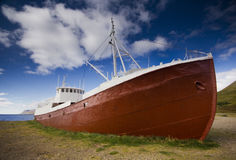Iceland Old Boats. Old Iceland metal boat out of water Stock Images