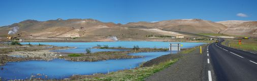 Iceland panoramic view of turquoise blue lake near road 1. The lake and its milky blue water and contrasts with chestnut mountains and pure blue sky stock photos