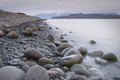 Iceland: Pebbly beach. Pebbly beach in northern iceland at midnight Stock Image