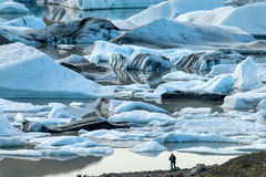 Iceland. Photographer with tripod in a glacier lagoon in Iceland Royalty Free Stock Image