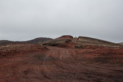 Iceland, red volcanic desert and car Royalty Free Stock Photography