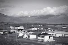 Iceland retro. Djupivogur - small fishing town in Iceland. Mountains and fjord. Black and white tone - retro monochrome color style Stock Image
